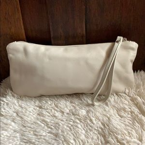 Rough and tumble leather clutch